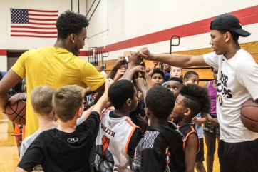 Mizzou Hoops players Torrence Watson and Javon Pickett lead a group cheer.